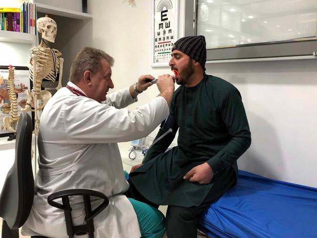 Dr. Vladimir examining a patient