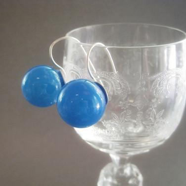 Semi-opaque blue blown hollow earrings , 1/2 inch diameter - $22