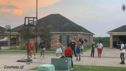 Police officer joins basketball game with local youth members of Rayne