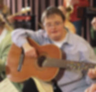 Man with downs syndrome plays guitar