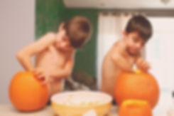Two-boys-carving-pumpkins.jpg