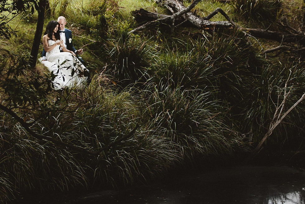 Hunter Valley Country Wedding - Bride and Groom sitting on the edge of creek