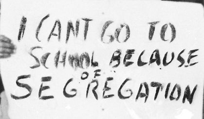 """sign reading """"I can't go to school because of segregation"""""""