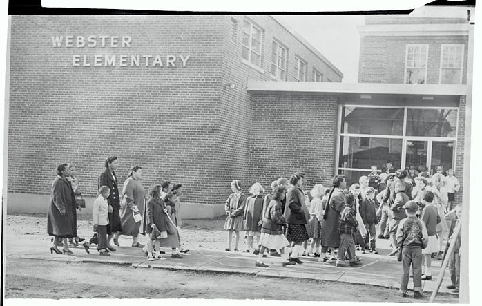 African American Parents Walking with Their Children to Segregated School