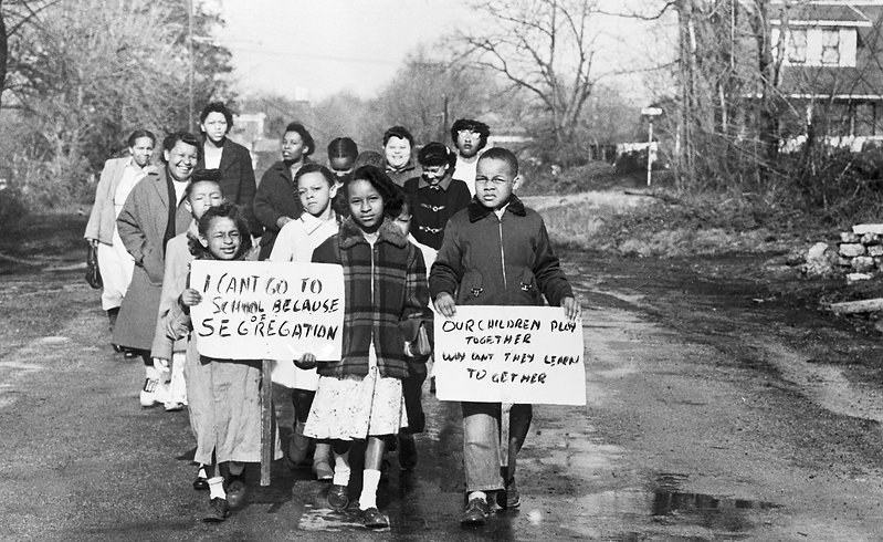 Mothers and children march against school segregation