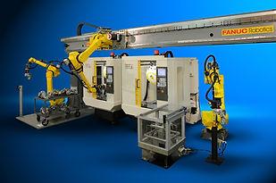 MH- 2 ROBOTS EN RIEL EN CNC.jpg