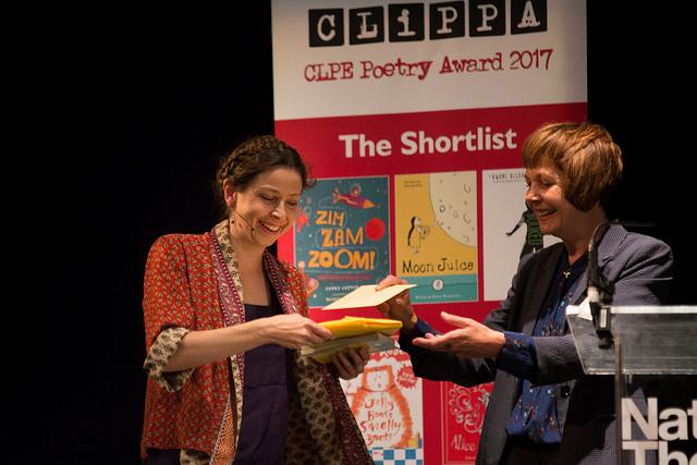 Kate Wakeling receiving her prize.