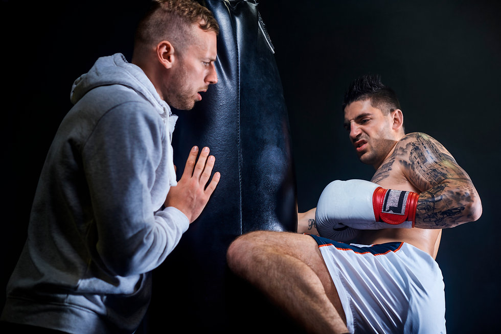 male-coach-supporting-muscular-boxer.jpg