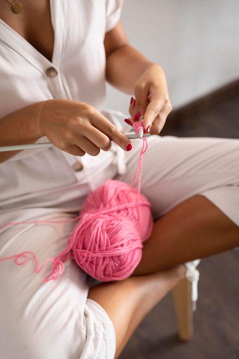 close-up-woman-crocheting-at-home.jpg
