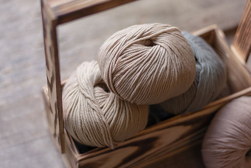 close-up-of-wool-knitting-on-wooden-back