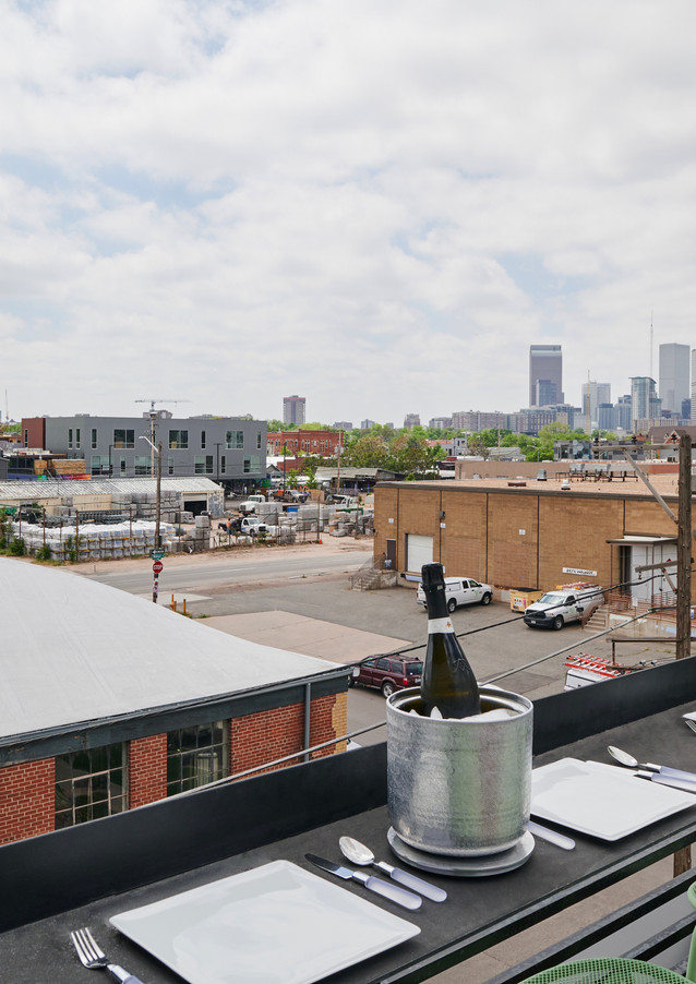 custom rooftop bar with views of RiNo, Crush Walls murals and Downtown Denver skyline