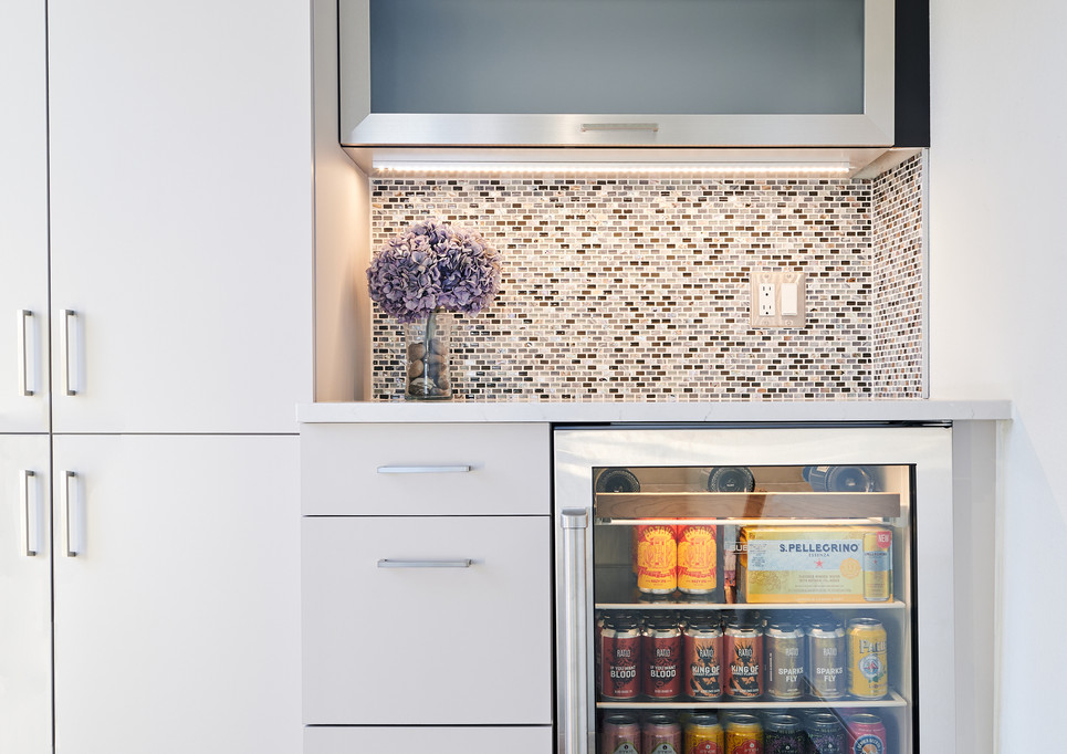 custom rooftop bar with Sub-Zero glass-front beverage refrigerator and Cambria Ella Quartz countertop // designed by Concept32 Designs