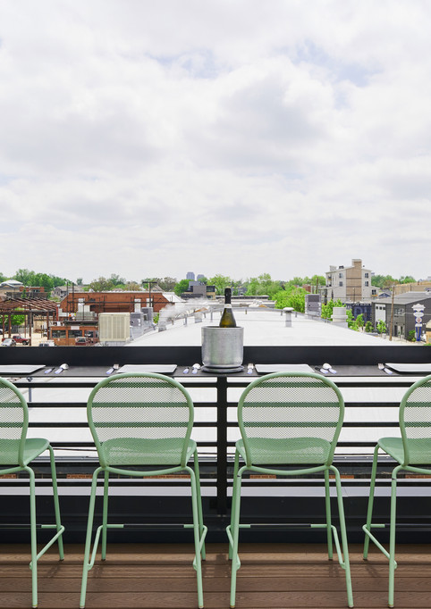 custom rooftop bar with seating for four
