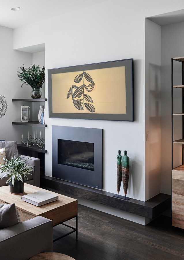 living room with custom built-ins and mantel