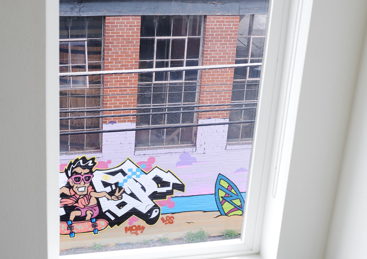 views of evolving murals on the west side of Epic Brewing Company