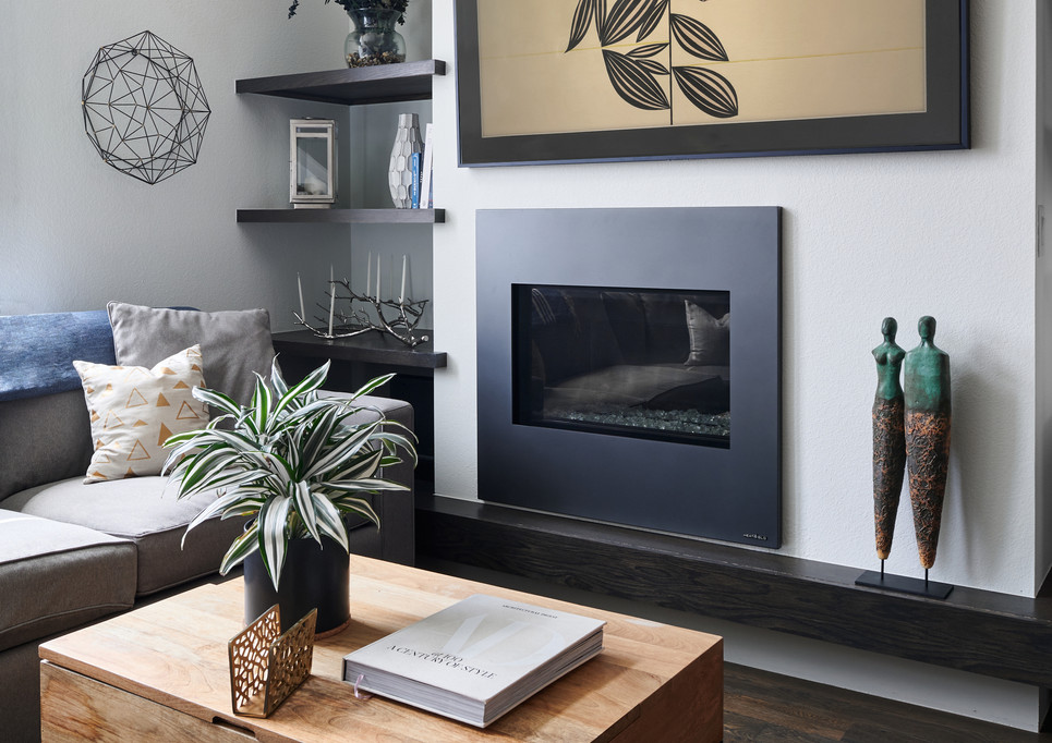 living room with Heat & Glo natural gas fireplace