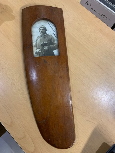 Trench art propeller picture frame.