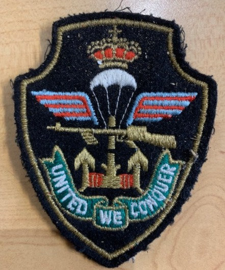 'United We Conquer' Commando patch. (Belgian or Dutch I think)