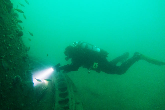 A diver getting close to the wreck on their Guided Dives in Scapa Flow