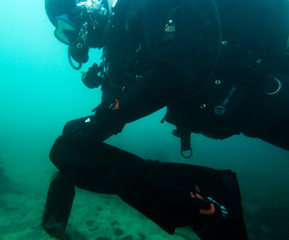 UK Dive against debris as a diver cleans up underwater trash