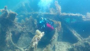 A diver swim-thru on the Empire Seamen.