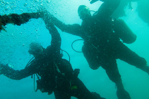 Divers descending into Scapa Flow