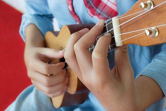 teen-girl-playing-ukulele-closeup-her-ha