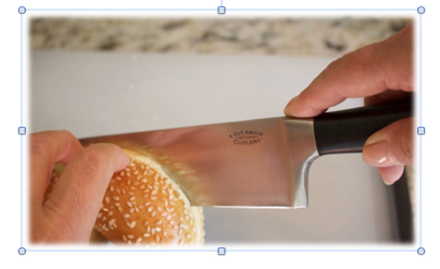 Guiding hand position for slicing a bagel
