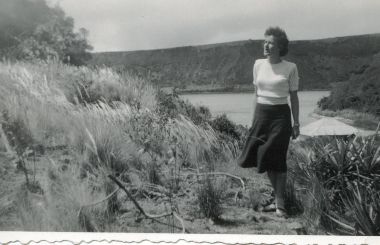 Renata Taube (nee Aron) standing in the wild -- ca.jpg