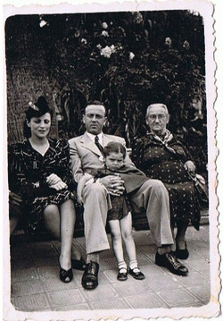 This is Margarita and Jose Reinsburg (my mom and dad), Herminia Reinsburg (my grandma)__and my siste