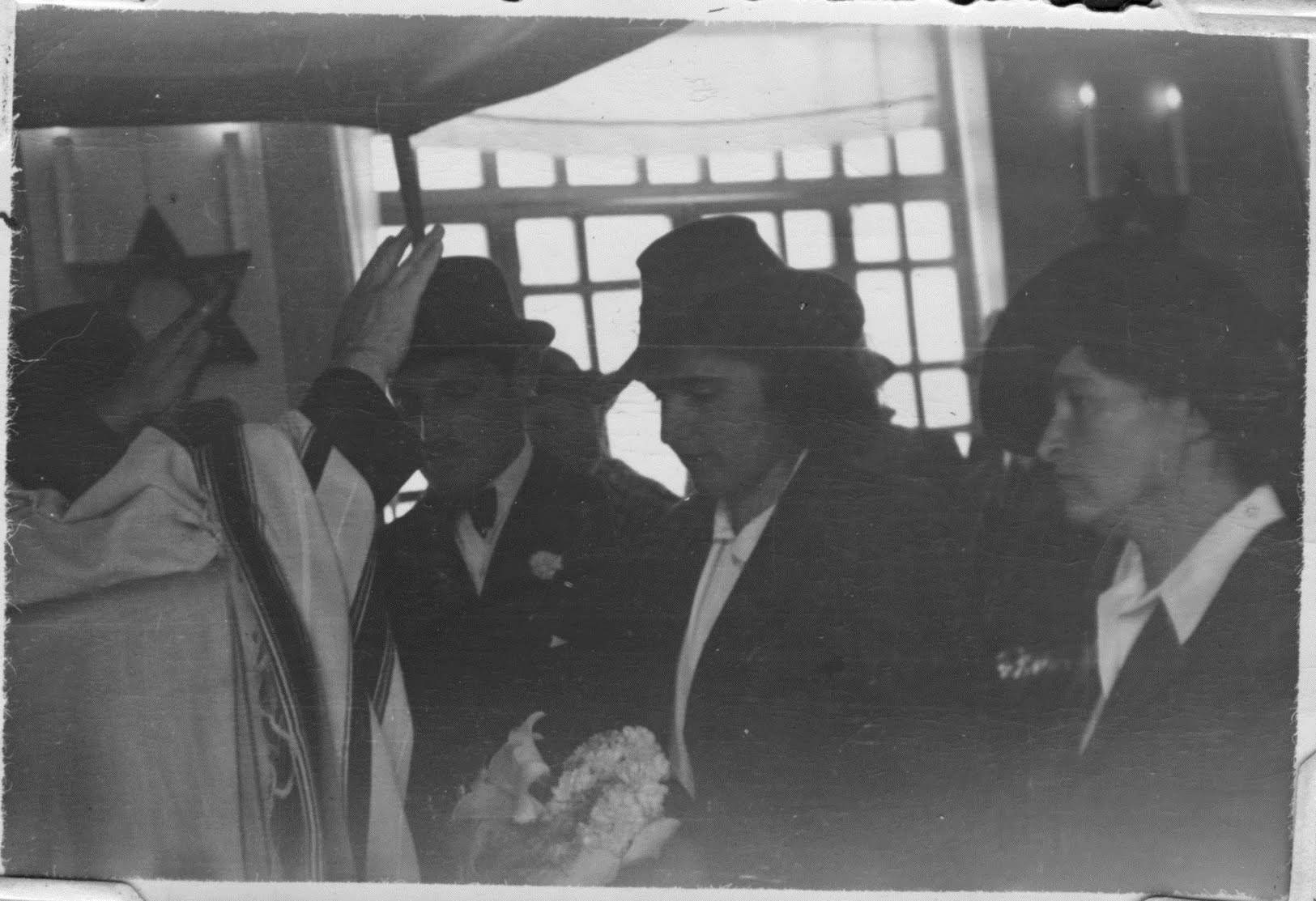 Salomon Neumann giving the priestly blessing to a newlywed couple in Quito, Ecuador -- 1944