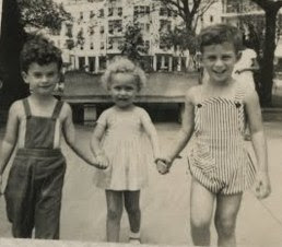 Niko Sifnaghel and Fred Grunewald holding hands with unidentified girl -- ca.jpg