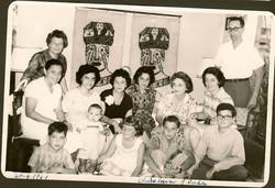 Christian Braasch's first birthday party.  Back row, far left_ Else Wellisch (nee Deller); far right