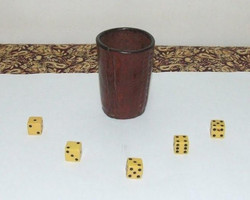 Attached photo of our original cacho cup and dice.jpg