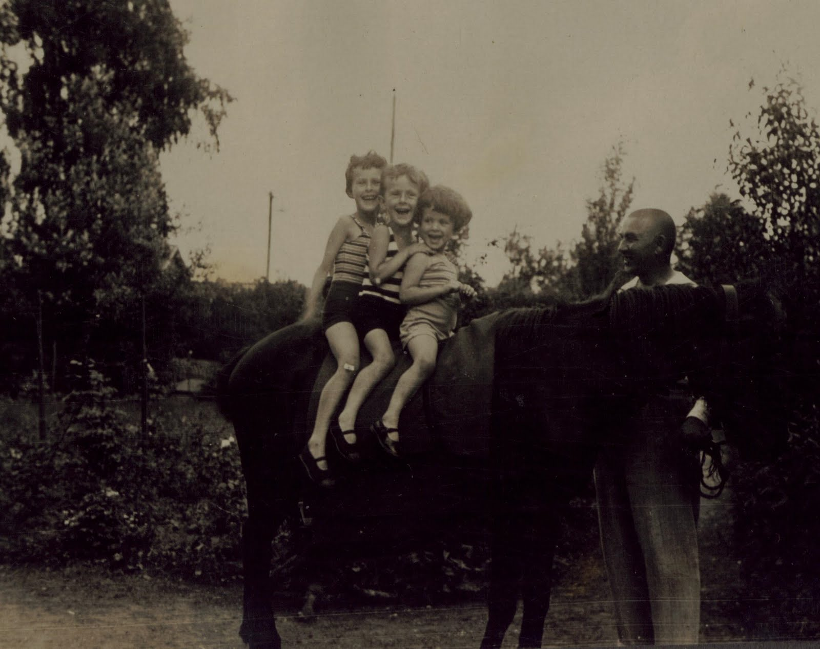 From left_  Renata Aron, Gert Aron & Marianne (Janne) Aron on horse -- July 1932