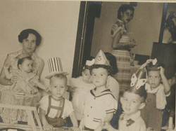 From left_ Dita Gumpel (nee Ginsberg) with daughter, Lynn Gumpel, on her lap; Ralph Janowitzer, Niko