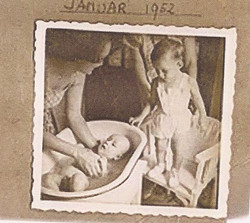 Gabriel Alexander being washed in the bathtub by my mother, Miriam, while Fred Grunewald is watching