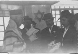 Salomon Neumann officiating at a wedding in Quito, Ecuador -- 1944