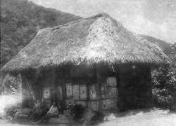 Hut at the end of the road from Banos, awaiting mule transport to Puyo.jpg