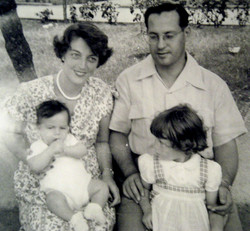 Ilse Grunewald (nee Koppel) holding son, Ralph, and Heinz Grunewald, with daughter, Peggy  -- 1956,