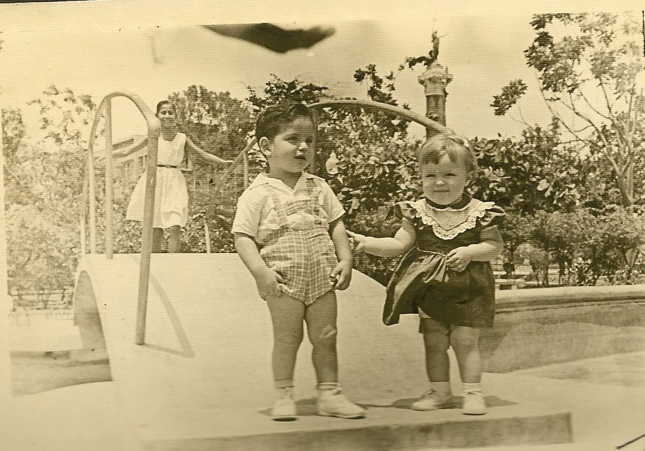 Ralph Grunewald (with unidentified girl) in Parque Centenario -- ca.jpg