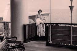Gerda Gumpel on the deck of the ship _Patria,_ on her family's journey to Ecuador from Hamburg, Germ