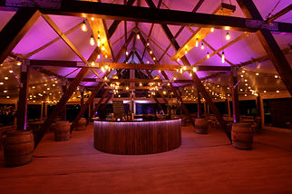 Cruck-tent-for-events-wedding-hire-bar-interior-Husk-Marquees