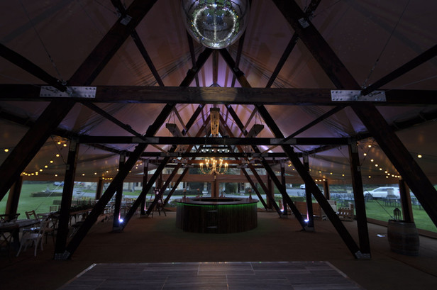 Cruck-tent-for-party-hire-night-interior