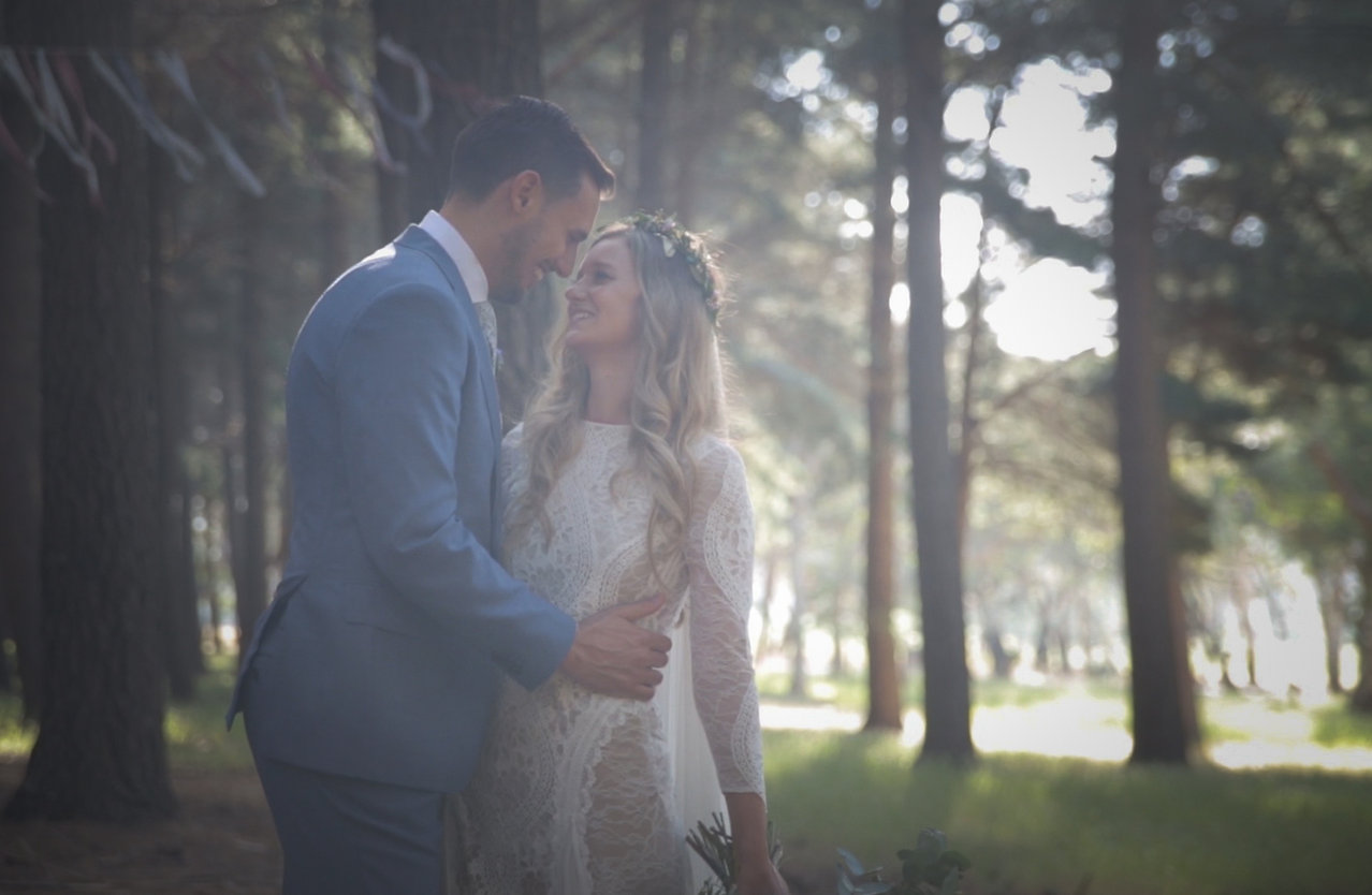 Premiere Films captured this happy couple in the forest on their wedding day.