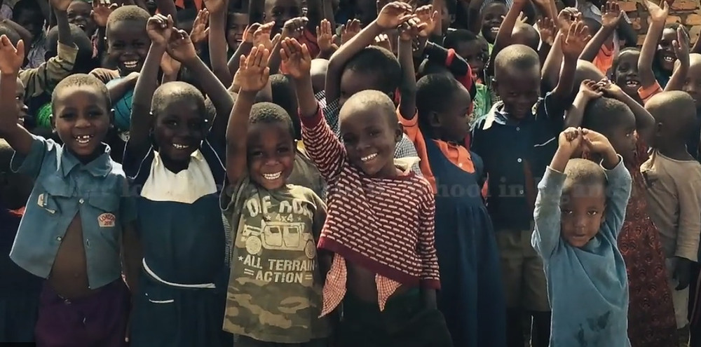 group of children with their arms up