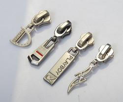 Metal zip puller