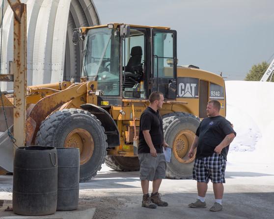 Workers at salt depot