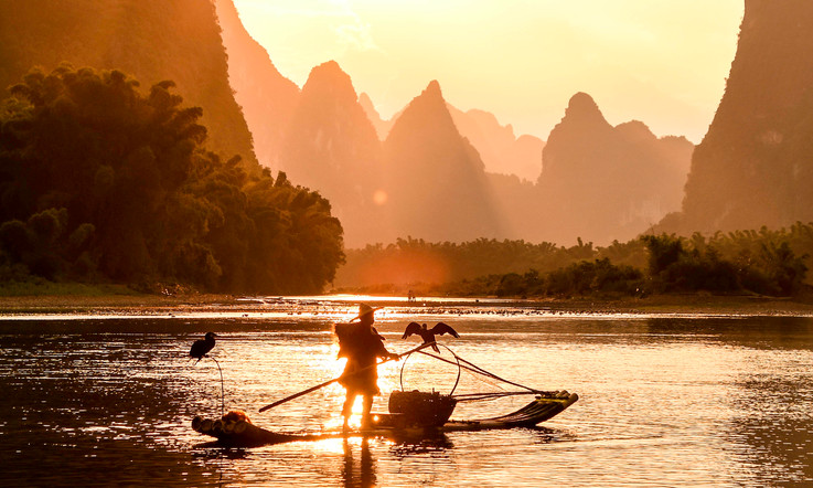 Cormorant Fisherman, China at sunset