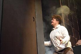 Renfield kneels by door with fog. Scene from Bram Stoker's Dracula.